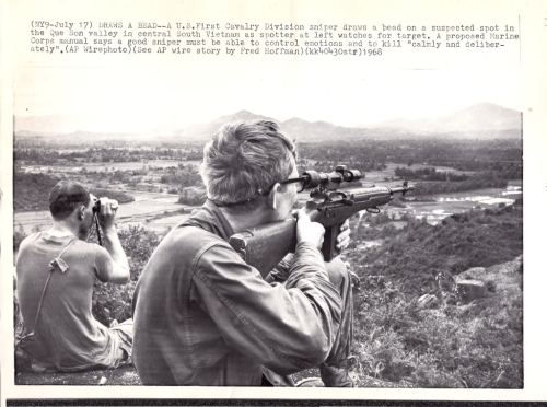 "warinvietnam:  A U.S. First Cavalry Division sniper draws a bead on a suspected spot in the Que Son valley in central South Vietnam as spotter at left watches for target. A proposed Marine Corps manual says a good sniper must be able to control emotions and kill ""calmly and deliberately"". A.P. Wirephoto July 17 1968"