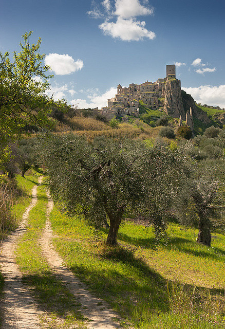 medievallove:  Craco and olive trees by Swiatlocien on Flickr. Via Flickr: The ghost town Craco, Basilicata, Italy. Abadoned village.