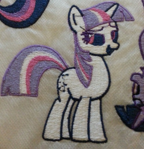 ethepony:  My embroidery machine takes 15 different colors at once, and this is what happens when you are off by 1 color.  Twilight looks evil.  ok ngl this is hella rad. pastel goth twilight.