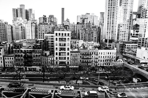 "New York City - Roosevelt Island Tram view. Midtown.—-   I have been afraid of heights since I can remember. Even stepping on a tall foot stool would send me into a frenzied panic. It's partially a control issue and partially an irrational fear of the eternal ""what if"" quandary related to my own mortality. And yet, I have discovered as I get older that there is something supremely thrilling about being high up above things especially being high up above New York City. It's the same scattered sense of adrenaline-fueled excitement I get when I consider the vastness of the ocean. And in some ways, I think both vantage points offer the same sense of displaced wonder.   A month or so ago, I watched an absolutely incredible video called Overview which examined something called the Overview Effect. The Overview Effect is ""a cognitive shift in awareness reported by some astronauts and cosmonauts during spaceflight, often while viewing the Earth from orbit or from the lunar surface."" I can't recommend the video highly enough. It's a 15 minute short film that explores different astronaut's life-altering experiences viewing the earth from above for the first time. The footage of earth from above in the film is overwhelming. It's an emotional journey of a film that definitely has lodged its way into my consciousness. Here it is:   Overview  A few years back, when I went to the top of a skyscraper I had never been to the top of before, I had such an incredibly visceral reaction when I experienced seeing the city from above. It was rough for me to even take the elevator up 70 floors to the observation deck. I clenched my sweaty fists and closed my eyes the whole time deep breathing probably much to the amusement (or dread) of the fellow elevator passengers. Once I stepped out and onto the upper deck, I was hooked. It was as if I was seeing the city for the first time. Once you take yourself out and away from the streets that surround you, it's as if the city opens up its arms to you. It's fascinating to consider all of the activity and stories that are contained in any one part of such a view.  In the short film I linked above, one of the astronauts describes the Overview Effect saying that common features include a feeling of awe for the planet, and a profound understanding of the interconnection of all life among other perspective-shifting feelings. And I really think that anytime we take ourselves high above or deep below the reality we experience every day, it produces different (subtler when it comes to standing on the top of a skyscraper and perhaps more overwhelming in regards to being deep in the ocean) versions of the Overview Effect.  Since experiencing that amazing feeling when I pushed past my fear of heights to take myself high above my own every-day reality, I have actively pushed myself to seek out as many high vantage points as I can. This particular image (taken with the Sony A99) was taken high above the 59th Street Bridge (also known as the Ed Koch Queensboro Bridge) entrance overlooking the buildings and skyscrapers that make up the New York City skyline in midtown Manhattan.      —-View this photo with a comment thread on my Google Plus page—-View ""Midtown Manhattan Skyscrapers and Streets from Above"" in my photography portfolio here, email me, or ask for help."