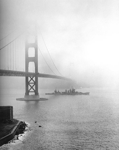 The USS San Francisco steams under the Golden Gate Bridge in 1942, during World War II