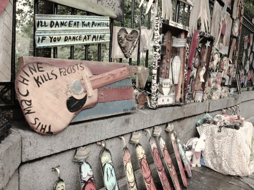 "so-treu:  amemusicale:  Street art around Jackson Square in New Orleans.  that ""i'll dance at your funeral if you dance at mine"" sign? want."