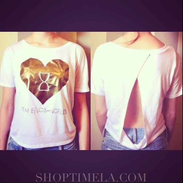 NEW 'Hourglass Heart' GOLD FOIL TOP AVAILABLE FOR PREORDER NOW AT SHOPTIMELA.COM! Very limited quantities available until further notice. Get yours while you can! #timelosangeles #shoptimela #goldfoil #fashion #summer #cute #heart #gold