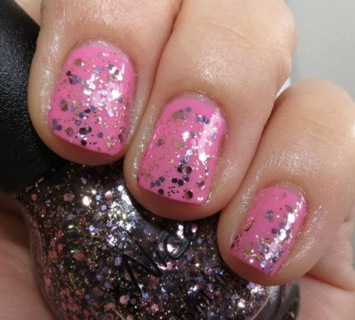 "Selena Gomez' ""Naturally"" with ""Inner Sparkle"" on top, from her Nicole by OPI Nail Polish Collection!"