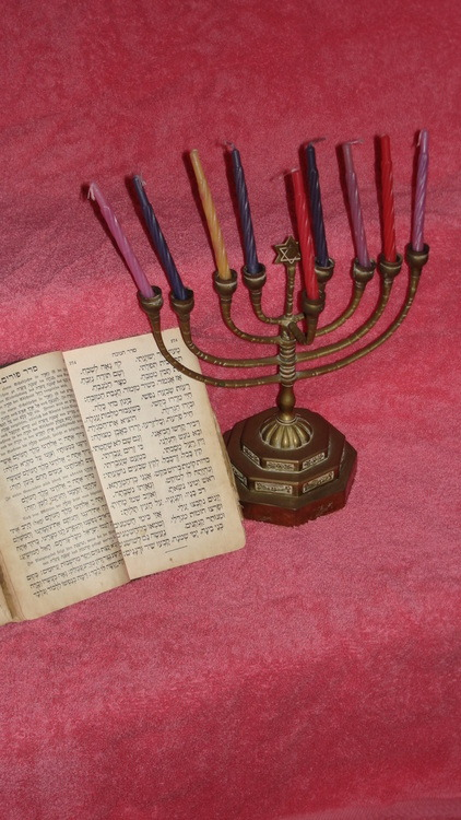 Items saved during Holocaust. Chanukkah menorah was saved by a Christian woman. The prayerbook survived 3 years of my incarceration in the Terezin concentration camp in Czechoslovakia