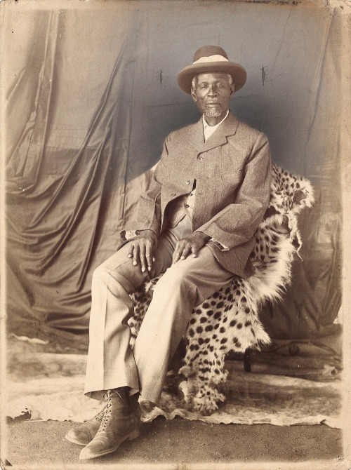 "NOTABLE AFRICANS: Portrait of King Khama III, South Africa, early twentieth century. Kgosi Khama III became chief of the Ngwato in 1875. He visited Britain in 1895 on a self-funded journey with other chiefs, and successfully protested against the possible transfer of the administration of the Bechuanaland Protectorate to the British South Africa Company. A cropped version of this portrait was printed in a leaflet, ""Khama: The Great African Chief,"" distributed by the London Missionary Society in 1923. Smart & Copley, Bulawato, also published the image as a postcard. Read more about King Khama III."