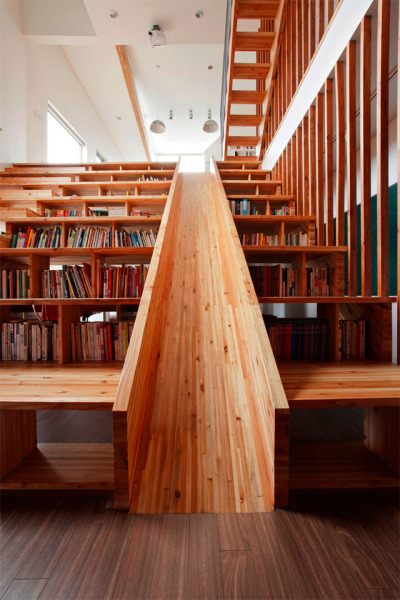 chicagopubliclibrary:  Library Slide By Moon Hoon via Colossal:  Architect Moon Hoon recently designed the Panorama House (scroll down), in Chungcheongbuk-do, South Korea. One of the most unique features incorporated into the home is a wooden slide built directly into a library which also functions as a stair-stepped home theater seating area.  Click here to see more photos of the Library Slide!