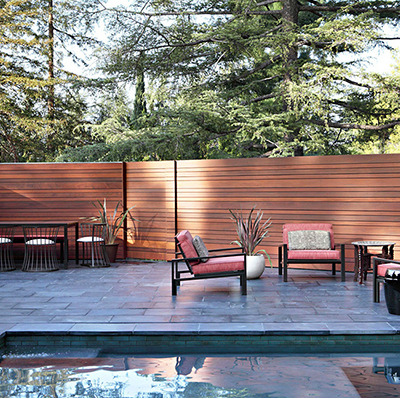 Interesting Ipe fence for the pool area at La Canada Mid-Century in Los Angeles, California.   I wasn't able to find out who designed the fence but the house renovation was done by interior designer Jamie Bush & Co.