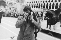 60sforever:   Alain Delon takes photographs on the Place Saint-Marc during the test for the filming of the movie 'Marco Polo' on March 12, 1962 in Venice, Italy.