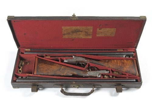 A cased pair of William Powell and Sons side by side shotguns.