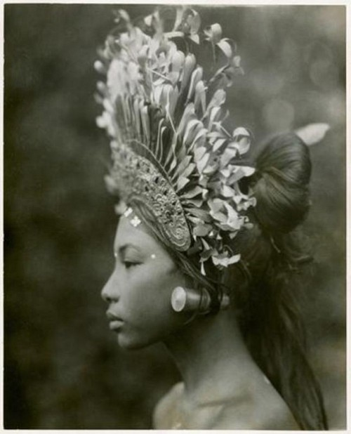 "burnedshoes:  © Andre Roosevelt, 1930s, Bali dancer A towering headdress and plug earrings adorn a 1930s Balinese djanger dancer, part of a coed performance that was ""more of popular fun than of temple dance or disciplined art,"" wrote Maynard Owen Williams in his March 1939 National Geographic article, ""Bali and Points East."" The dance's male participants ""at times resemble a troupe of cheer leaders made up like Groucho Marx,"" noted Williams. (+)"