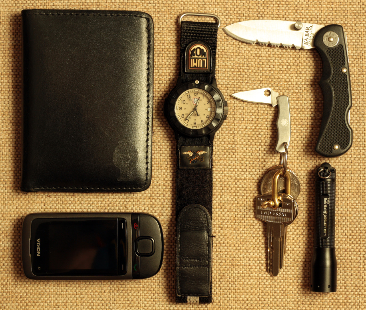 Everyday Carry Submitted By: Themistius   Very nice EDC's guys. I have seen some useful items i will add to my everyday carry as soon as possible. So, let's talk about my EDC,that it's rather simple and not that expensive but it served me well for some time now,and i am satisfied with it:   Polizia di Stato wallet made by RADAR Luminox Navy Seals First Edition - Purchase on Amazon KA-BAR 3000 Led Lenser P3 AFS - Purchase on Amazon Spyderco Bug and keys - Purchase on Amazon Nokia C2 - Purchase on Amazon   That's it!