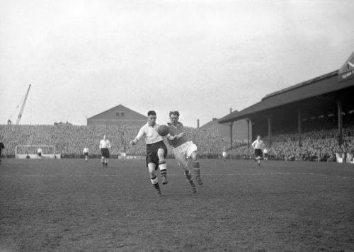 Fulham's Jim Taylor and Liverpool's Jimmy Payne battle for the ball at Craven Cottage, 1952