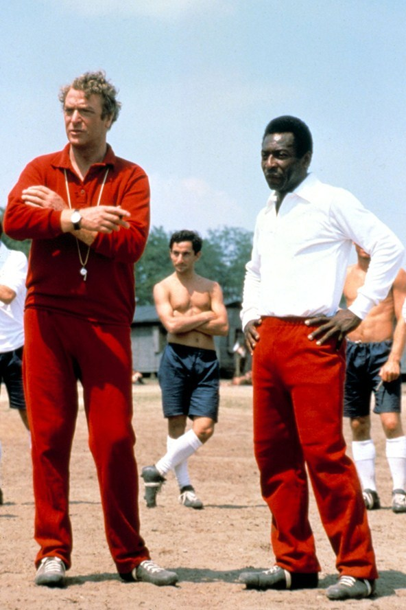 On the set of Escape to Victory. Michael Caine, Pele and renowned 'method' actor Ossie Ardiles, 1980. Source: British GQ