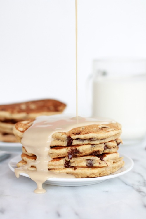 breakfastwithalex:  I must try this. Image credit and recipe: halfbakedharvest.com  Whole Wheat Chocolate Chip Banana Bread Pancakes with Vanilla Coconut Glaze    Prep Time: 10 minutes Cook Time: 15 minutes Total Time: 25 minutes   Yield: makes about 12 pancakes    Ingredients Banana Bread Pancakes: 2 cups whole wheat pastry flour 2 teaspoons baking powder 1/4 teaspoon salt 1/4 cup brown sugar 3 large ripe bananas, mashed 2/3 cup milk (I used 2%) 1 tablespoon vanilla extract 1 egg 2 tablespoons coconut oil, melted 3/4 cup dark chocolate or semi-sweet chocolate chips (you dont have to use an chocolate or you can use more than this. I did.) Vanilla Coconut Glaze: 1 (15 ounces) can coconut milk (regular or lite) 1/2 cups brown sugar 2 teaspoons vanilla extract Instructions In a large bowl, combine the flour, baking powder, sugar and salt. In medium mixing bowl, mash the bananas and add the milk, vanilla, egg and melted coconut oil. Whisk to combine. Fold the wet ingredients into the dry ingredients. Stir until a smooth batter forms, but be sure not to over mix. Stir in the chocolate chips and allow the batter to sit five minutes. Well the batter rests begin the vanilla coconut glaze. Mix the coconut milk, brown sugar, and vanilla in a small saucepan. Cook the mixture over medium heat, stirring it constantly, until it comes to a boil. Reduce the heat to medium and let it simmer for 10-15 minutes until it thickens into a syrup, it will thicken slightly as it cools. (Be carful not to let the mixture boil as it will change the consistency). While the glaze simmers, heat a skillet or grill on medium heat. Using a 1/3 cup measure, spoon batter into rounds and cook until bubbles form on top – about 2-3 minutes. Flip and cook for a minute or two more. Repeat with remaining batter. Serve hot with the vanilla coconut glaze.