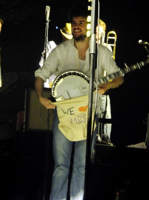 "Winston Marshall of Mumford & Sons with a ""gift"" thrown on stage by a fan at the Mitsubishi Electric Halle in Düsseldorf, Germany on 3rd April, 2013. Photo submitted by Hanna on twitter."