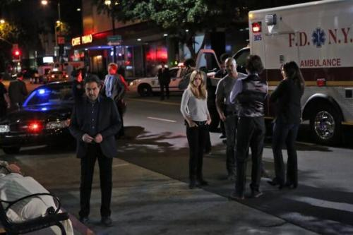 @CrimMinds_CBS: Check out an exclusive photo from the May 22 season finale of #CriminalMinds!   Let's see.. Rossi, JJ, Morgan, Reid, and Blake. I think that *might* be Hotch standing back near a police car, but can't be sure. Rossi looks like he's contemplating. Taking guesses: Body on the bench could be Strauss. Other options: Agent Anderson or Kevin Lynch. Or just some random schmuck.