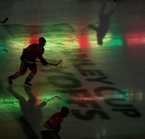CHICAGO, IL - APRIL 30: Members of the Chicago Blackhawks skate during player introductions before taking on the Minnesota Wild in Game One of the Western Conference Quarterfinals during the 2013 NHL Stanley Cup Playoffs at the United Center on April 30, 2013 in Chicago, Illinois. (Photo by Jonathan Daniel/ Getty Images)