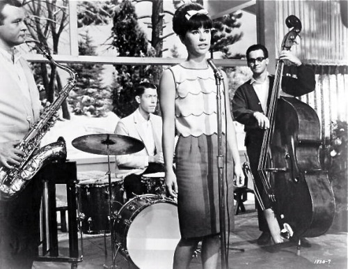 "anovabossa:   Astrud Gilberto and Stan Getz in the film Get Yourself a College Girl, described as ""A curious 1964 hybrid of teen movie musical with pre-feminist overtones as well as a parody of moralistic anti-rock message films."""