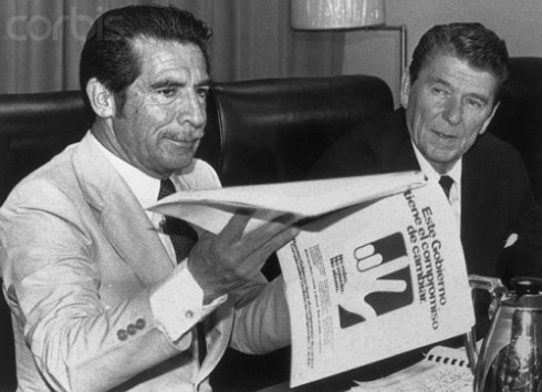 guatepolitics:  sihubogenocidio:  U.S. President Ronald Reagan meets with General Ríos Montt after he came to power in 1982 via a U.S.-backed military coup.  Ohhhh, Ronnie… Many Latin@s remember Reagan as the father of IRCA, which regularized immigration status for many Latin@s in the US. South of the border, though, he was kicking it with Ríos Montt and hand-waving at (correct) allegations that the US was supporting a genocidal military dictator.  I reblogged this photo not too long ago, but I'll do it again to direct everyone's attention to this review of Greg Grandin's The Last Colonial Massacre (which I haven't managed to find a copy of, but I've seen enough of Grandin's work to feel confident in recommending it) by Corey Robin. The opening paragraph makes a great caption for this photo:  On 5 December 1982, Ronald Reagan met the Guatemalan president, Efraín Ríos Montt, in Honduras. It was a useful meeting for Reagan. 'Well, I learned a lot,' he told reporters on Air Force One. 'You'd be surprised. They're all individual countries.' It was also a useful meeting for Ríos Montt. Reagan declared him 'a man of great personal integrity . . . totally dedicated to democracy', and claimed that the Guatemalan strongman was getting 'a bum rap' from human rights organisations for his military's campaign against leftist guerrillas. The next day, one of Guatemala's elite platoons entered a jungle village called Las Dos Erres and killed 162 of its inhabitants, 67 of them children. Soldiers grabbed babies and toddlers by their legs, swung them in the air, and smashed their heads against a wall. Older children and adults were forced to kneel at the edge of a well, where a single blow from a sledgehammer sent them plummeting below. The platoon then raped a selection of women and girls it had saved for last, pummelling their stomachs in order to force the pregnant among them to miscarry. They tossed the women into the well and filled it with dirt, burying an unlucky few alive. The only traces of the bodies later visitors would find were blood on the walls and placentas and umbilical cords on the ground.