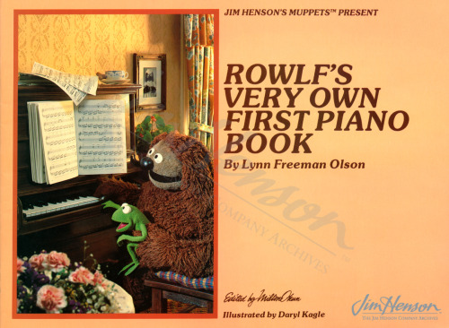 Rowlf shares his musical talents with Robin on the cover of Rowlf's Very Own First Piano Book edited by Milt Okun.