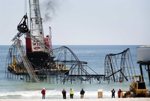 Crews tear down iconic coaster destroyed by Sandy via NBCNews John Moore / Getty Images Lucas Jackson / Reuters Mark Wilson / Getty Images