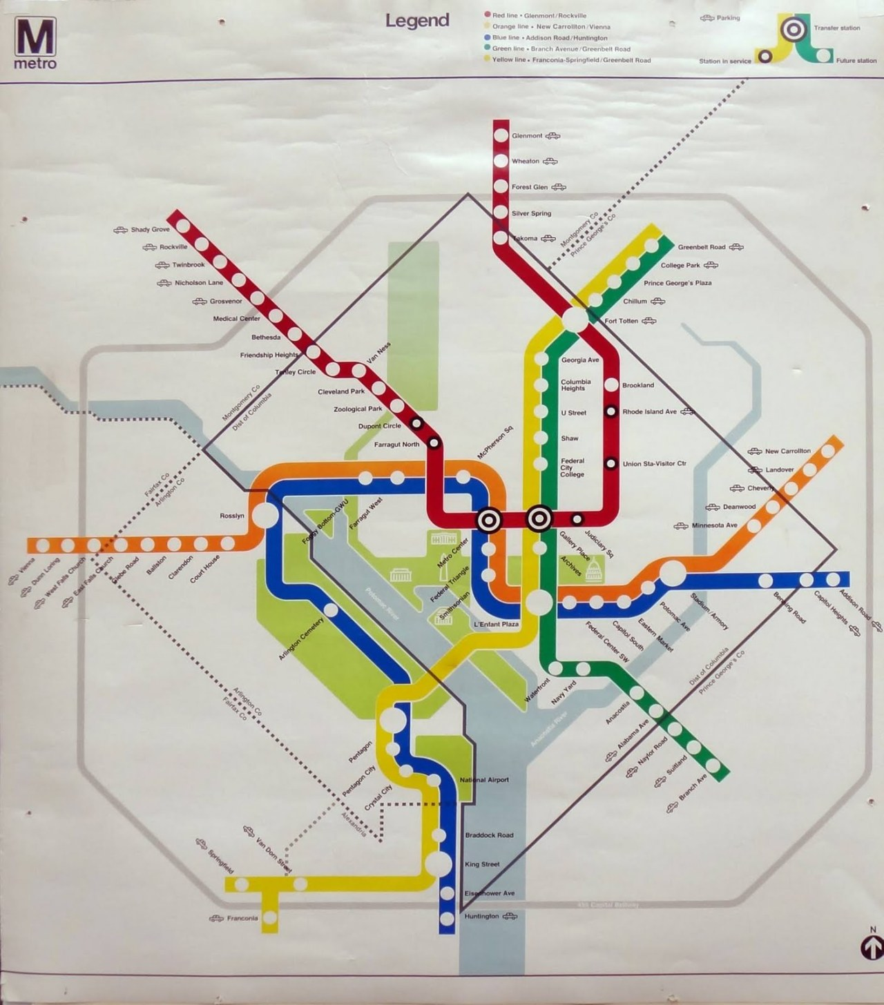 "Historical Map: Washington, DC Metro Map, 1977 As you know, I've had a lot to say about recent iterations of the Washington, DC Metro Map (Rush+ map review, draft Silver Line map review), but how about a look at where it all began? This is a Metro map from March, 1977 — about a year after the system first started carrying passengers. At first glance, it looks very similar to today's modern map… but then you realise that the only section that's actually in service is the Red Line between Dupont Circle and Rhode Island Avenue, denoted by black outlines around the station circles, rather than the plain white circles used for future stations. The uncanny resemblance to today's map comes about because the whole system shown here — up to and including the opening of the Green Line segment to Branch Avenue in 2001 — was planned for right from the start of the project. If you look closely, there are actually quite a few differences: the Blue and Yellow Lines south of Pentagon are reversed from today's configuration, and a number of station names have changed from these initial plans. Bigger visual differences include the lack of the kink in the Yellow/Green line around Columbia Heights and a much greater sense of visual clarity: short station names (note that it's only ""U Street"" here!) and no secondary information like cross streets, hospitals or timetable/routing callout boxes give the map room to breathe. While not quite the mimimalist classic that Massimo Vignelli's New York Subway map is, this version of the map is definitely far more deserving of the ""iconic"" tag than its modern descendants. Our rating: An unadulterated look at the far superior original concept. Four stars.  (Source: Subchat.com thread about the map: the thread originally dates the map to March 27, 1976, but later revises it to March 17, 1977 because of the stations that are shown as being open — Dupont Circle and Gallery Place stations opened after the rest of the Phase I Red Line stations)"