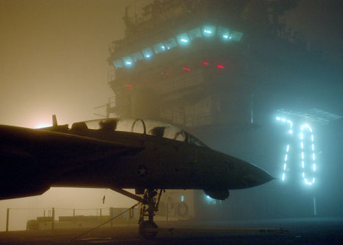 Naval Station Bremerton, Wash. (Oct. 24, 2002) — Early morning fog sets across the flight deck of the aircraft carrier USS Carl Vinson (CVN 70) before her scheduled underway period later in the morning. The crew of the Carl Vinson is conducting training in preparation for their next scheduled deployment. U.S. Navy photo by Photographer's Mate 3rd Class Martin S. Fuentes. (RELEASED)