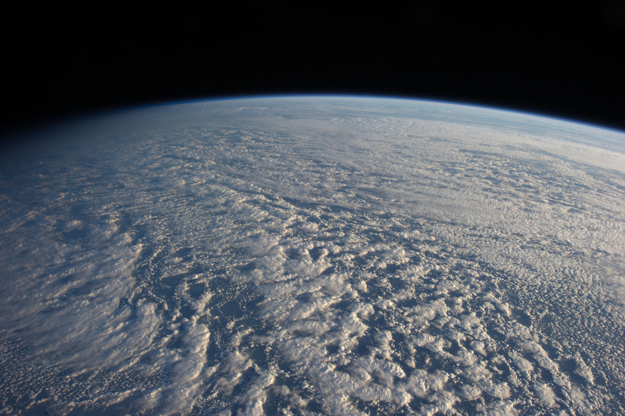 Stratocumulus Clouds  ISS034-E-016601 (4 Jan. 2013) —- On Jan. 4 a large presence of stratocumulus clouds was the central focus of camera lenses which remained aimed at the clouds as the Expedition 34 crew members aboard the International Space Station flew above the northwestern Pacific Ocean about 460 miles east of northern Honshu, Japan. This is a descending pass with a panoramic view looking southeast in late afternoon light with the terminator (upper left). The cloud pattern is typical for this part of the world. The low clouds carry cold air over a warmer sea with no discernable storm pattern.