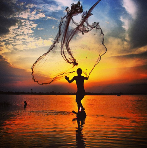 Sunset net fishing in Thailand.