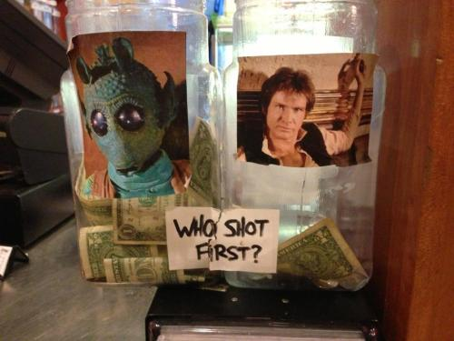 Greedo versus Han Solo tip jars (via @hyams)  It makes me sad that Greedo's is fuller.  UPDATE: @Hyams responds:     . @austinkleon ah, see that's the brilliant part. i think they dump the $ on greedo's side to make you want to throw more in han. tip troll.   See also: Tupac vs. Biggie  Filed under: signs