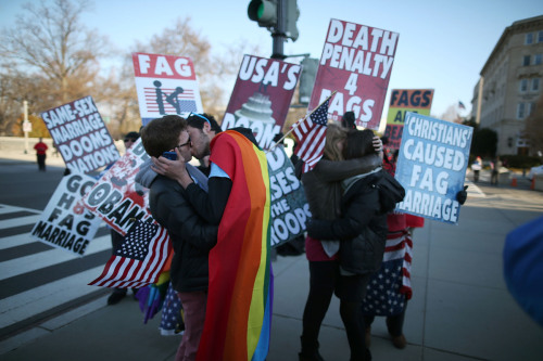 queef1ng:  b0dy-snatchers:  Gay couples kissing in front of the Westboro Baptist Church's protestors. Despite the protestor's aggressive warnings, the couples were in fact NOT  smote on site by the wrath of God.  I LOVE THIS SO MUCH OMG.