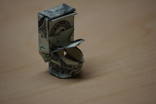 Dollar bill toilet to flush away all your problems. It's really small. Designed by Won Park.