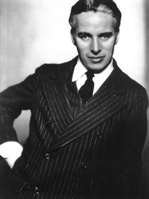 "chaplinfortheages:  williemckay:  Charlie Chaplin, 1920s.  Lovely portrait of Charlie circa 1925 Can anyone spot ""the little tramp"" :)"