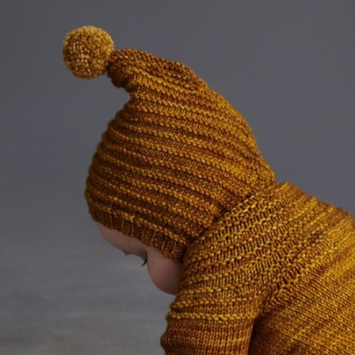 Tree ring bonnet has very quickly become a favorite this season. Bonnet style with two little wooden buttons under chin. 100% hand dyed merino. Hand knit in Peru. Available in our shop/link in profile  #mishaandpuff http://ift.tt/1t7WuTh