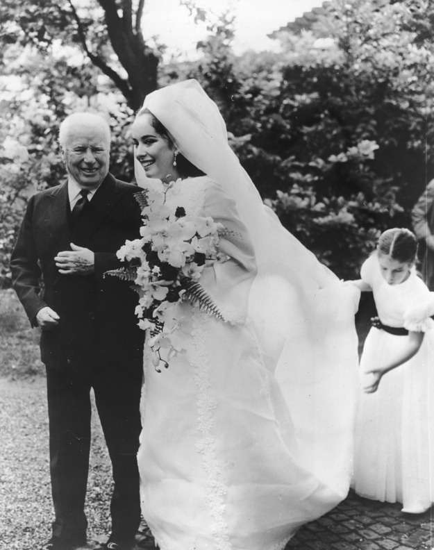 chaplinfortheages:  vintagebrides:  Charlie Chaplin prepares to escort his daughter Josephine down the aisle at her 1969 wedding in Lausanne, Switzerland.  Charlie looks like such a proud papa. The girl holding her dress may be her sister Annette (Annie) who was 10 years old at the time.