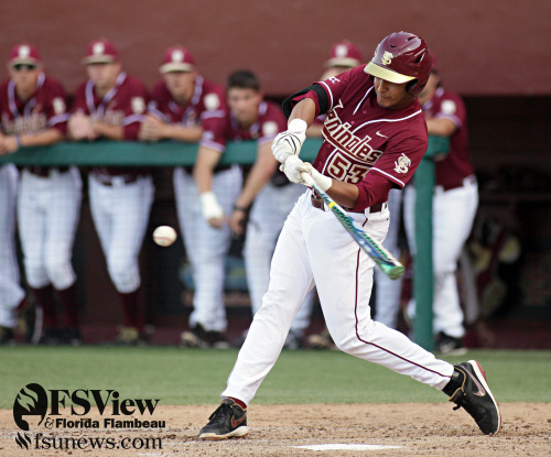 Jose Brizuela swings during the game against Florida on April 9 at Dick Howser Stadium in Tallahassee. The Seminoles couldn't hold on and lost to the Gators in the last inning 4-3.