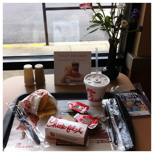 Enjoying a #kidsmeal @chickfila #justenoughfood #southern #christian #fabulouscustomerservice #flowersonthetable #freemints