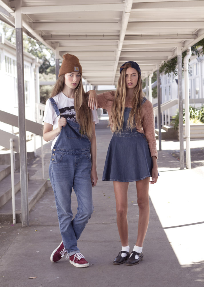 The new kids.  Zara: Glassons denim dungarees (dropping mid-April), Lonely Hearts tee, Carhartt beanie, Vans. Emma: NEUW sweater, Glassons denim pinafore dress, KIA x Little Brother cap, Topshop mary-janes. Photo: James K Lowe.