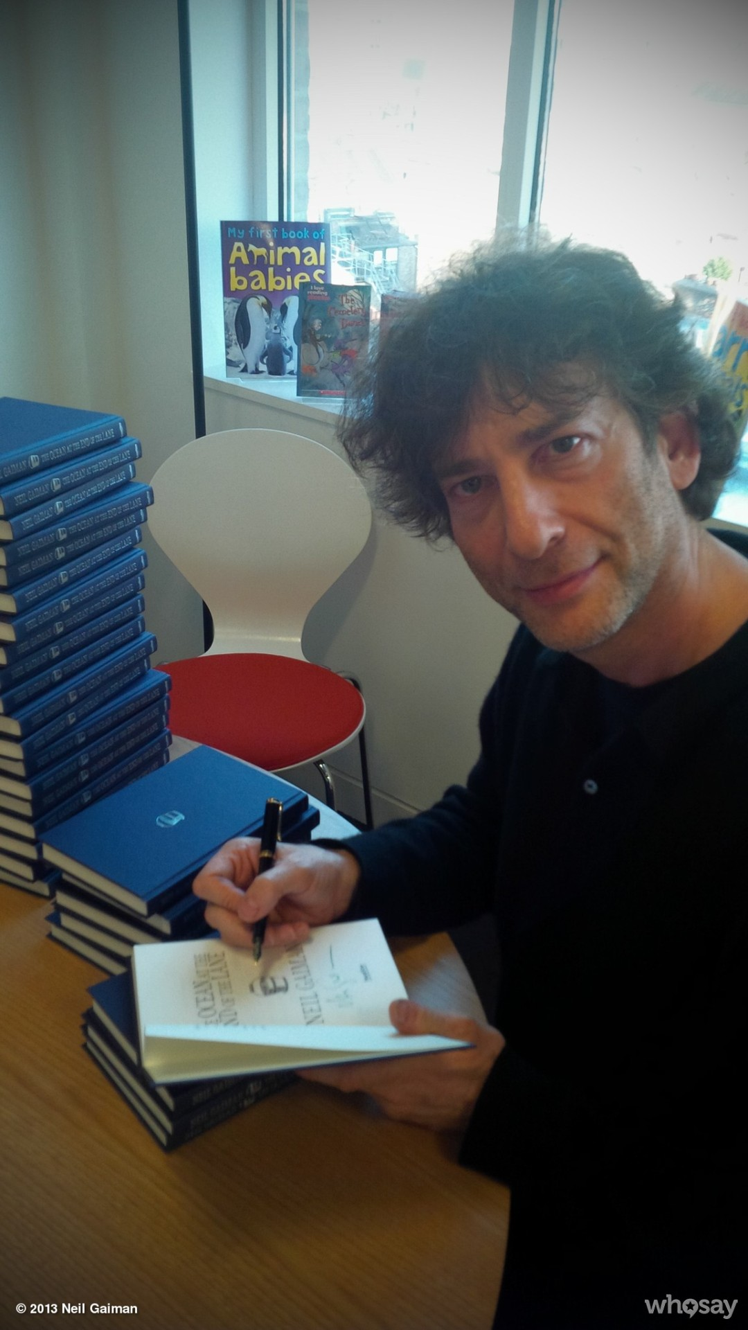 neil-gaiman:  Look! I'm signing them… View more Neil Gaiman on WhoSay