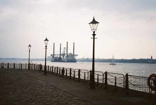 enchanted-ruth:  Shipping passing the Albert Dock, Liverpool February 2013 Olympus Trip 35