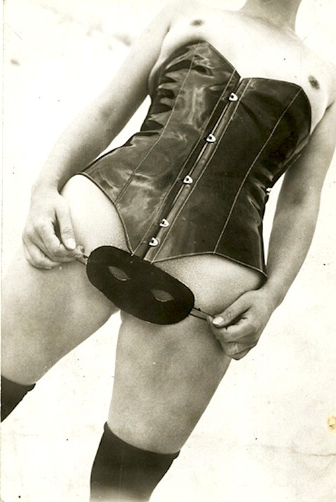 lauramcphee:  Woman in Leather Corset with Mask, c1930s (Jean Moral)