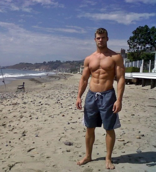 Muscular guy at the beach.