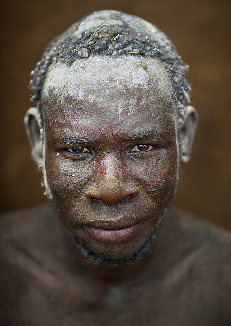 Bodi Tribe Man With Hair Decorated With Ashes, Hana Mursi, Omo Valley, Ethiopia by Eric Lafforgue on Flickr.Via Flickr: The Bodi (or Meen) tribe lives close to the Omo River in southern Ethiopia (Omo Valley) and has the Mursi tribe as south neighbor and Konso at north; It is a pastoral and agricultural tribe, thus livestock plays a large role in the tribe; Along the banks of the river, they cultivate sorghum, maize and coffee; For their new year in June, called Kael, Bodi men consume large amounts of blood and milk to become overweight;Â This tradition measures the body fat of a contestant; Each family or clan is allowed to present an unmarried contestant;Â The winner of this contest is awarded great fame by the tribe;Â The women in the tribe wear goatskin skirts and have a plug inserted into their chin; Most of them are now Christians; In Hana Mursi, the main town of the Bodis, the government plans to settle 300 000 people from all over Ethiopia over the next few years; Along with the workers and soldiers, AIDS and Hepatitis B are coming too; The Bodi tribespeople do not want to give up their traditions and their land to allow the new sugar cane plantations irrigated by the water of Gibe 3 dam, and live in the settlements planned by the government; If the Konso tribe attempts to set foot on their land with the support of the government, clashes will erupt as the Bodi elders predict; © Eric Lafforguewww.ericlafforgue.com