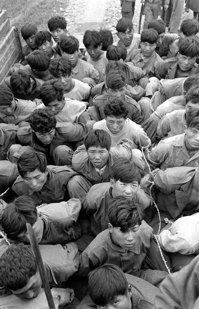 "life:  Photos from Korea's 1948 Yeosu-Suncheon rebellion  Caption from LIFE. ""Other rebels in army uniform are hauled away tightly trussed in army trucks, after their capture by loyal army forces, for trial by Korean military tribunal."" (Carl Mydans—Time & Life Pictures/Getty Images)"
