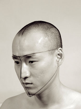 "Dukno Yoon from the Self-Portraits series 2001-2002 ""This project is based on my formal study of face, in which I simplify face to lines. Composed directly from and on face, using steel wire with tension, these sculptures have kinetic potentialities due to the dynamics of the human face. As woking on this project, linear structure and relationship with body have become the most important elements in my works."" (via Dukno Yoon / MetalWorks)"