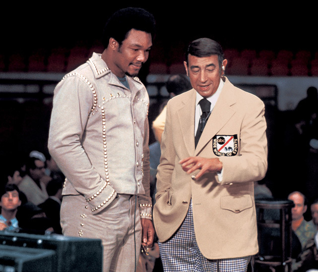 George Foreman and ABC Wide World of Sports commentator Howard Cosell chat before Foreman's weigh-in for his 1974 fight against Muhammad Ali. (Neil Leifer/SI)