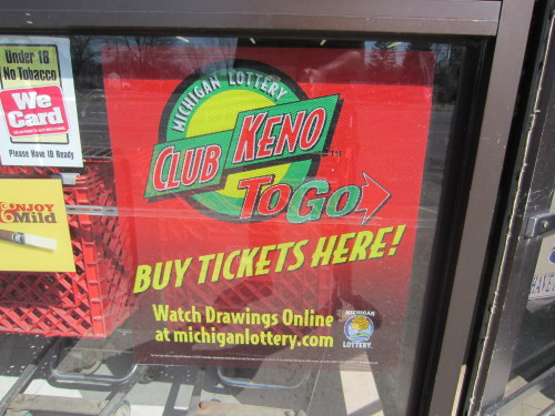 A picture of a Michigan Lottery Club Keno To Go poster, taken at a grocery store in Ida, Michigan on March 29, 2013.