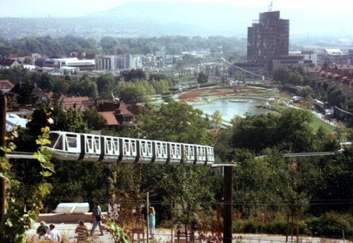 Jürgen Götzke has contributed a collection of photos of the monorail which ran at the international Garden Festival in Stuttgart in 1993 to the Wikimedia Commons.  The 4.6 km long circuit had significant gradients of up to 20% and was not confined to the exhibition grounds. There were five stops — Rosensteinpark, Wartberg, Messe, Höhenpark Killesberg and Leibfriedscher Garten. There was a depot in a small open space on Ehmann Road, near North Station.  After this exhibition, the monorail was dismantled. It was rebuilt in Gelsenkirchen's Nordsternpark in 1997 and used for that year's German Federal Garden Show.  It was again dismantled, and moved to Elbauernpark in Magdeburg, where it still runs as the Panoramabahn.