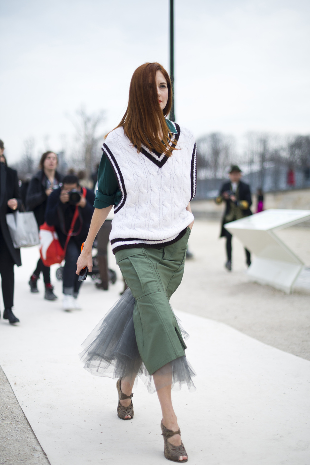 topshop:  A sheer tulle military skirt teamed with and a cricket vest is a winning look.